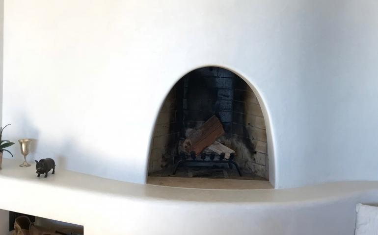 Adobe fireplace with bench and recess