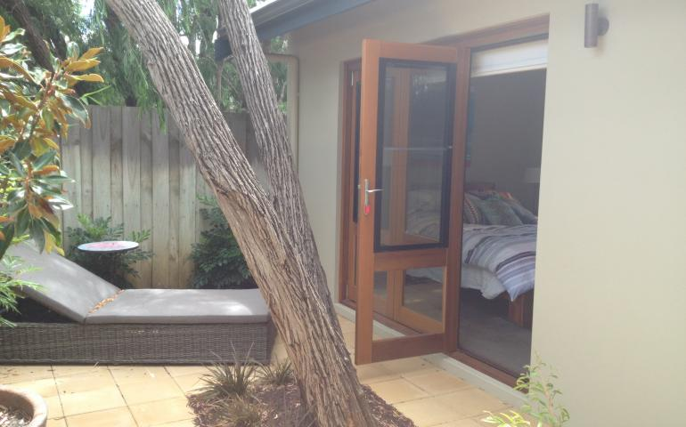 Private courtyard with peppy tree retained